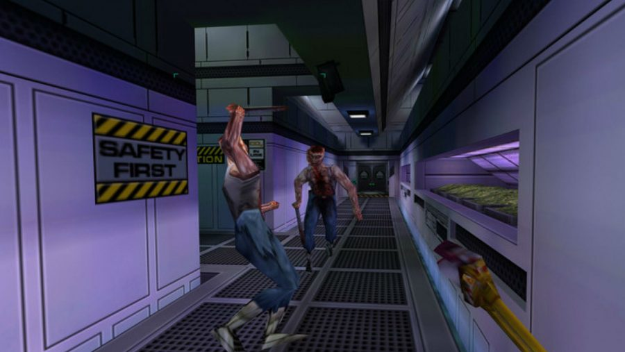 An altercation in a corridor in System Shock 2, one of the best old games. The sign on the wall reads 'Safety First'.