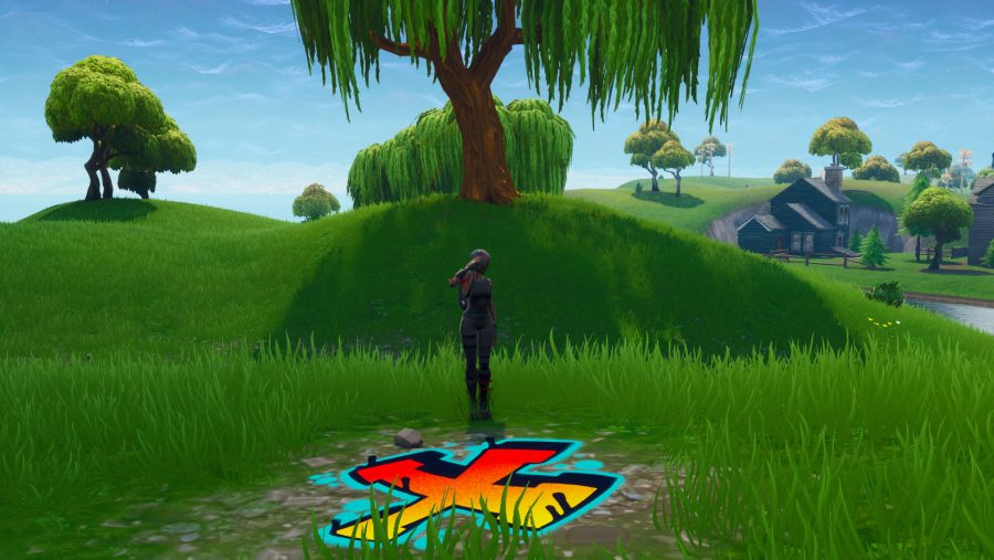 Fortnite: search between a covered bridge, waterfall, and the 9th