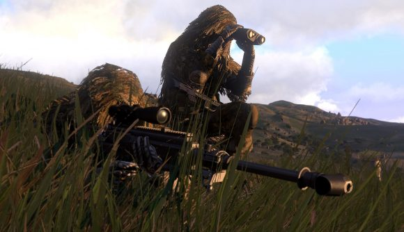 A sniper and their spotter on a hillside in Arma 3, one of the best multiplayer games