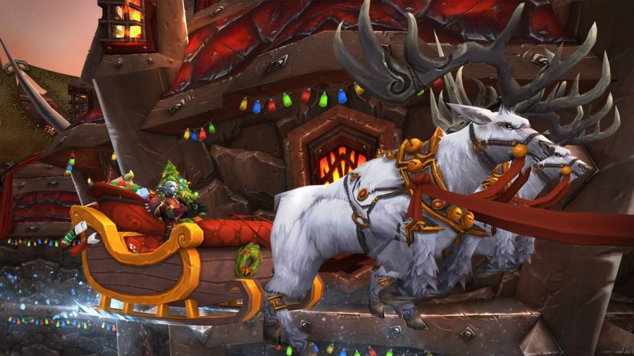 Two white reindeer pulling sled decorated with Christmas lights at WoW