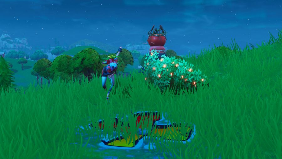 Fortnite search between giant rock man crowned tomato encircled tree location