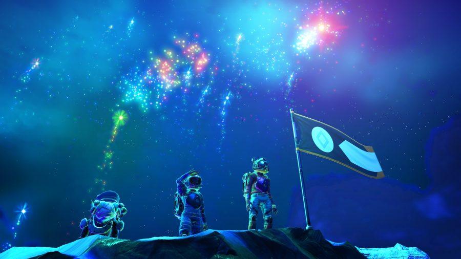 Des explorateurs au sommet tandis que des feux d'artifice illuminent le ciel dans No Man's Sky, l'un des meilleurs jeux d'artisanat