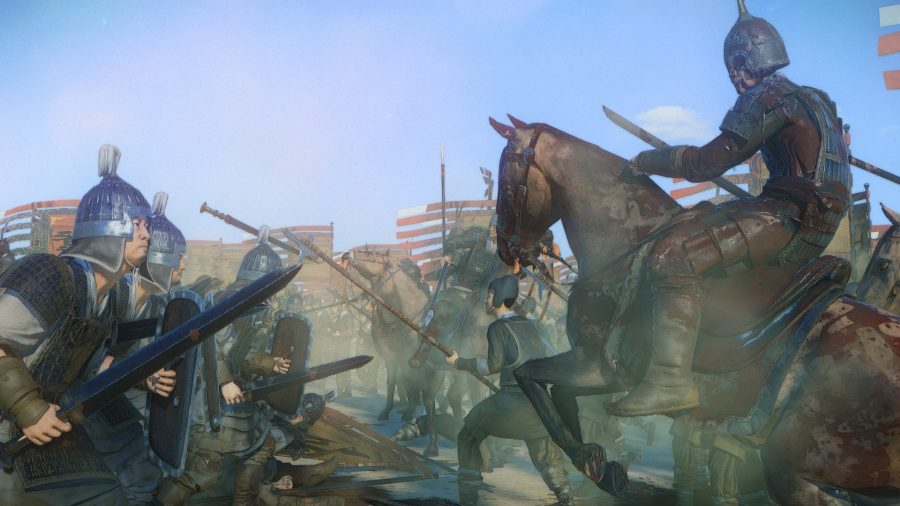 Bloodstained man on horse faces an armored man at his feet