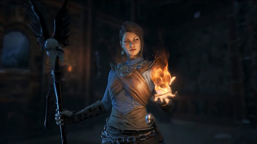 A witch holds a stick in her right hand and a torch in her left hand