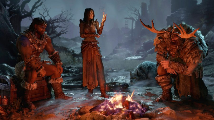 Diablo 4's Sorceress, Druid, and Barbarian sitting by a campfire