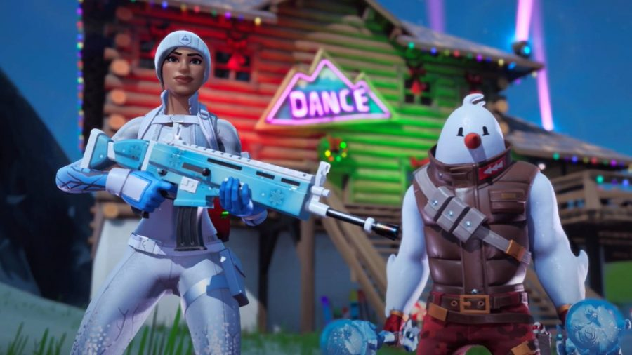 Two snow-themed Fortnite skins standing in front of a dance sign