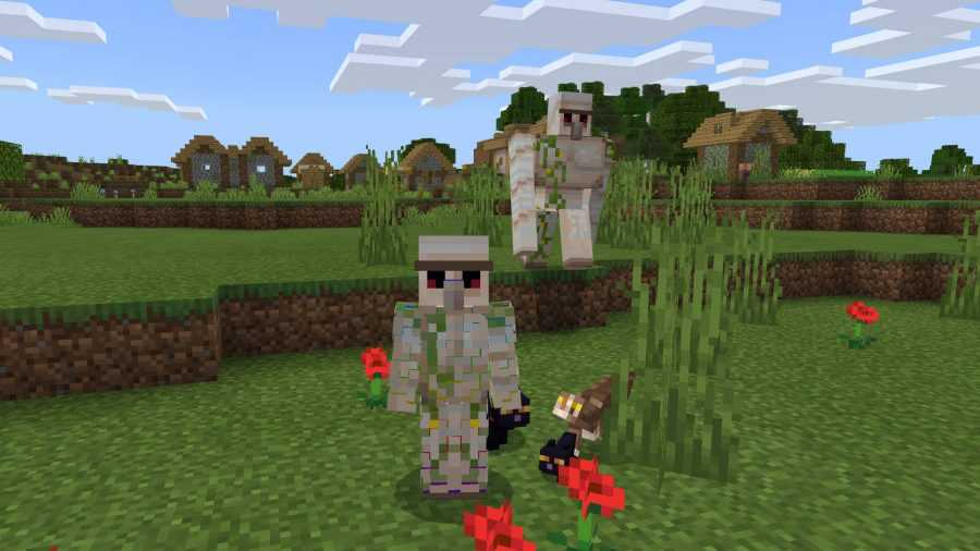 Player has a golem skin in Minecraft. He is standing next to a real golem and a bunch of cats.