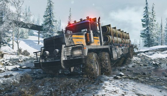 Huge truck driving through snow