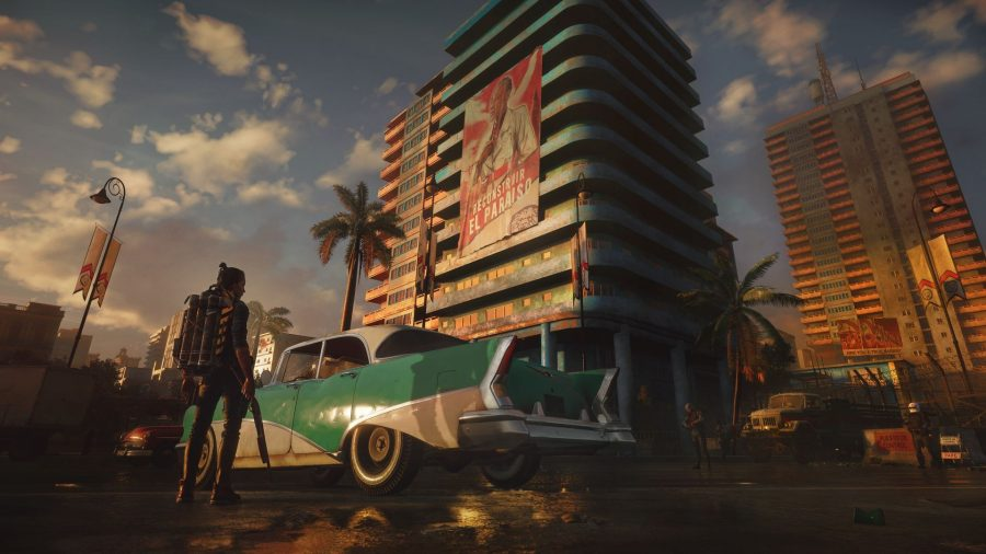 a man holding a shotgun, an old-style american car, and a run-down high-rise building