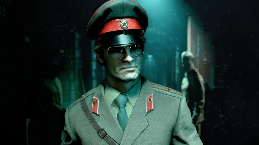 Russell Adler disguised as a Soviet officer, walking through a bunker. A guard is behind him.
