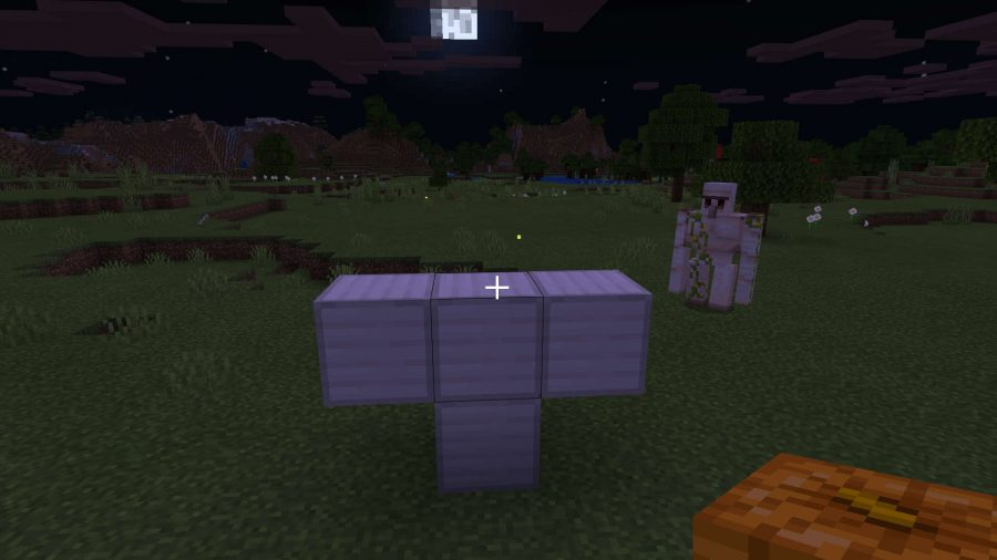 Create an Iron Golem to protect Minecraft Villages by placing iron blocks in T-mode, then popping a pumpkin carved on top for a head.
