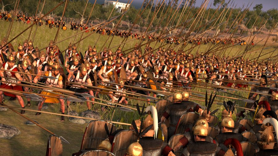Two armies clashing together. The romans have their shields up while the opposing armies have lances pointed at them.