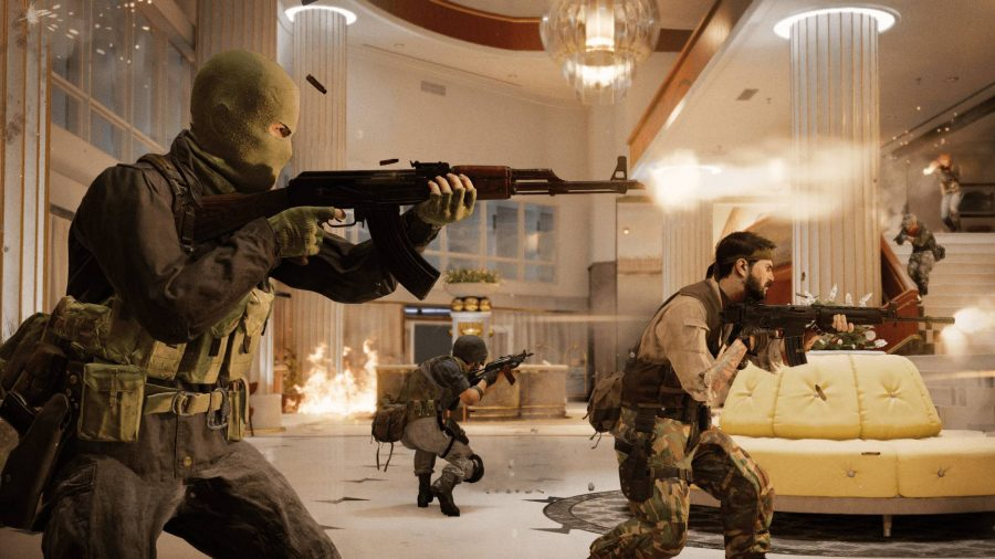 A squad in a bright hotel foyer shooting guns at another team in the Call of Duty Cold War beta