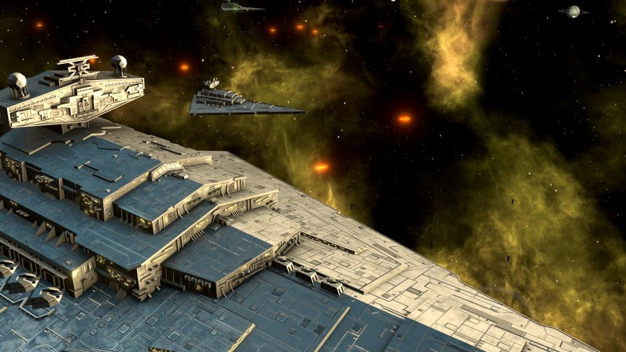 The Star Wars destroyer is in the foreground, with other destroyers in the background.  Laser firing.