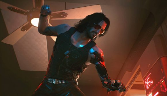 Johnny Silverhand, as depicted by Keanu Reeves, is about to punch someone. His fist is raised above his head.
