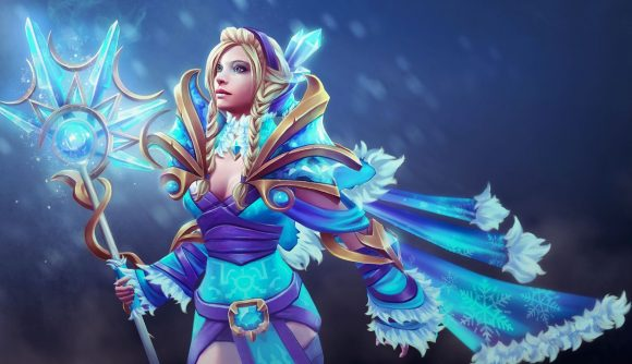 Dota 2 hero Crystal Maiden, wearing blue and gold armor, in front of an icy blue background