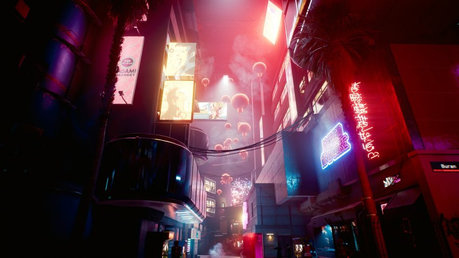 A busy market street illuminated by pink neon in Cyberpunk 2077