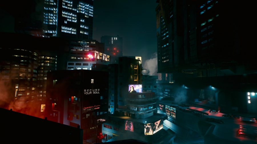 View of Night city at night from a rooftop in Cyberpunk 2077