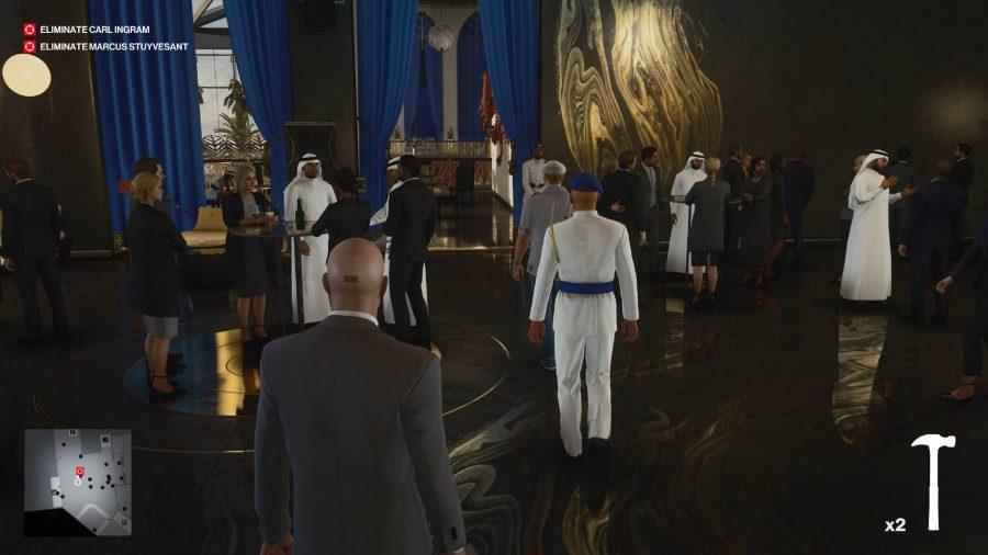Agent 47 walks through a crowd at an art gallery
