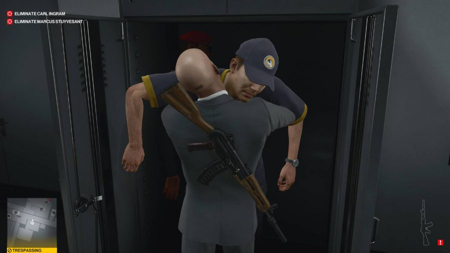 Agent 47 stuffs an unconscious guard in a cupboard