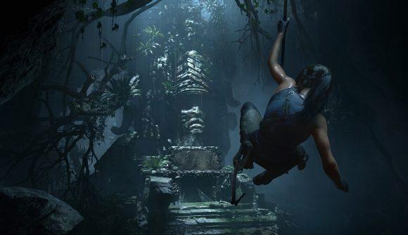 Lara Croft swinging towards an artefact inside of a tomb