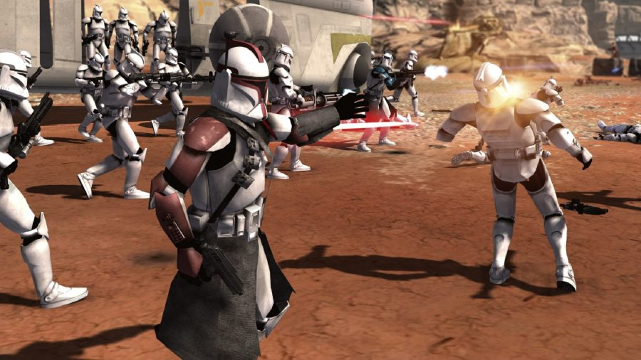 A clone captain with red styling leads other clones to battle, tracer fire all around