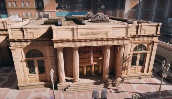 An exterior shot of Rainbow Six Siege's bank level, which is a classical-style, sandstone building in a modern city