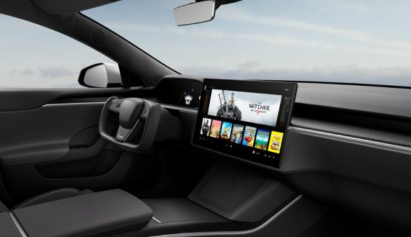 Black Tesla interior with large centre screen with The Witcher 3 displayed