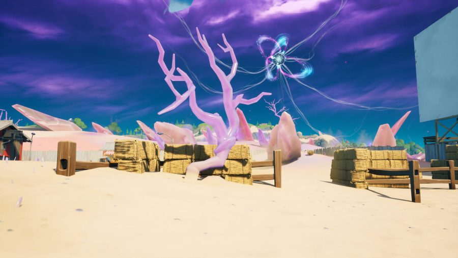 A crystal tree near the Zero Point in Fortnite. It's by some hay.