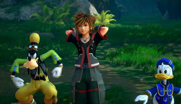 Sora, the main protagonist of Kingdom Hearts 3, stands next to Disney's Donald Duck and Goofy in a forest