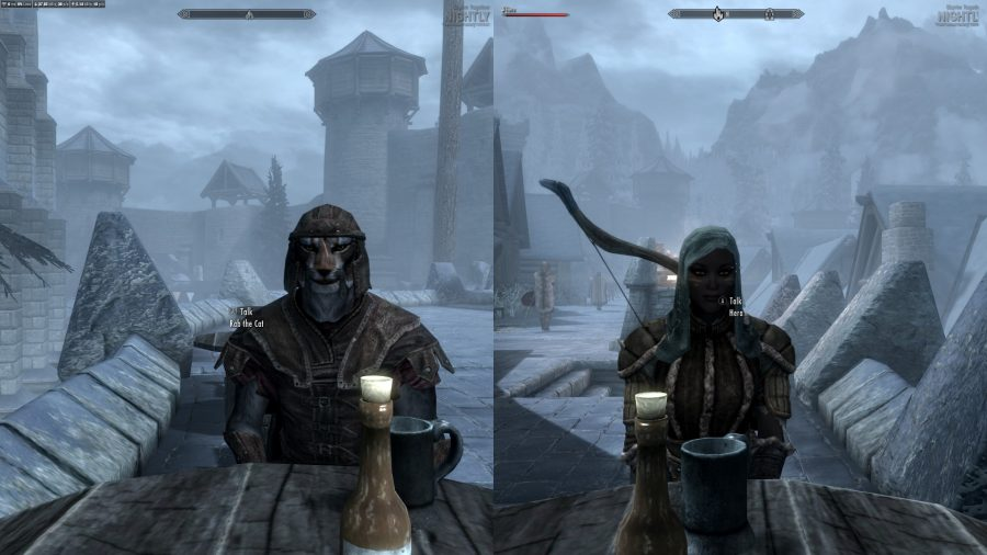 Two players sitting across from one another in splitscreen Skyrim