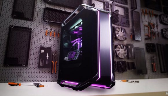 Cooler Master's Cosmos C700M case houses an expensive watercooled build and sits on a workbench in front of tools