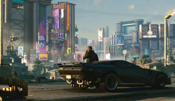 The protagonist of Cyberpunk 2077 stares out into Night City
