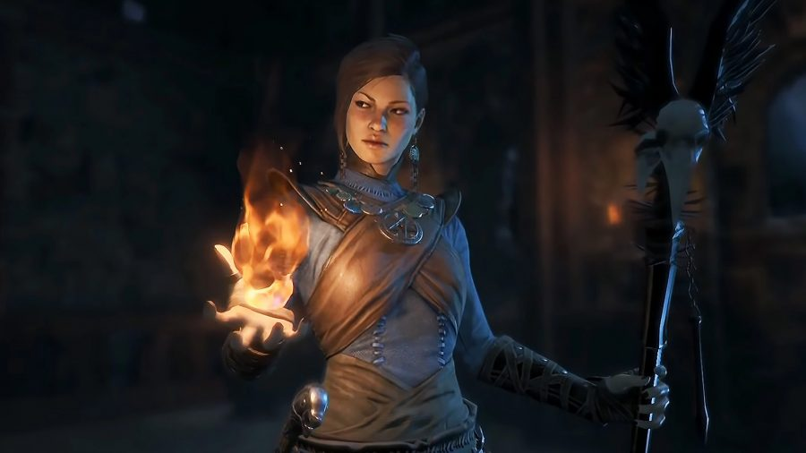 A Sorceress wielding a staff in her right hand and a flame in her left hand