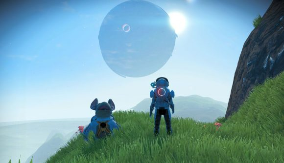 A spaceman stands next to his giant, rat-like pet looking at a blue sky and planet ahead