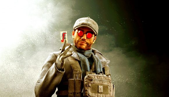 Flores holding up a card for his Rainbow Six Siege portrait
