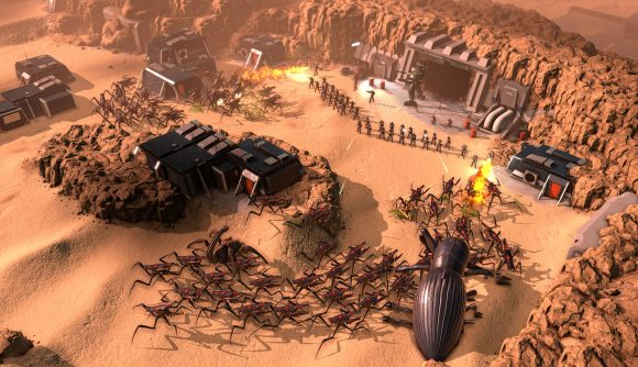 a line of infantry try to hold back waves of bug creatures in starship troopers