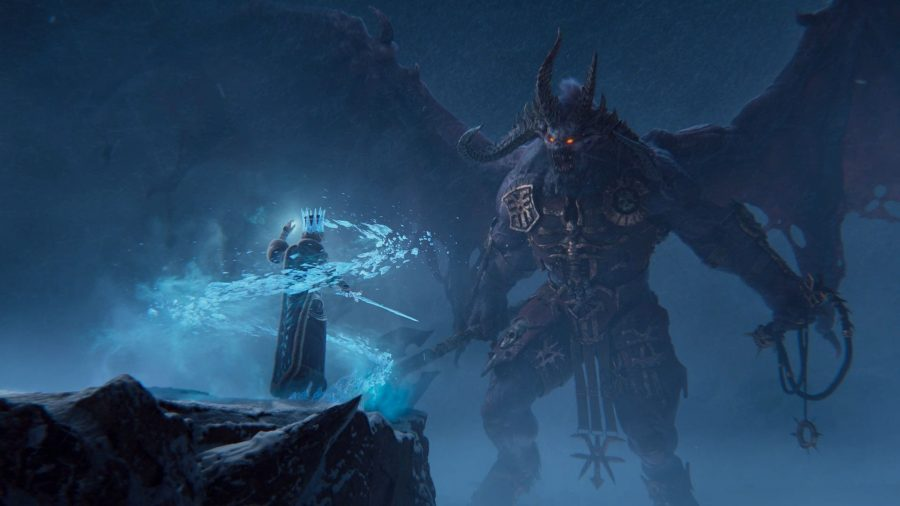 In Total War: Warhammer 3, a Bloodthirster confronts Tsarina Katarin of Kislev as she prepares to cast an ice spell