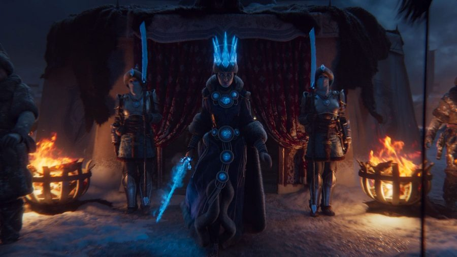 Tsarina Katarin of Kislev leaves her tent in Total War: Warhammer 3, flanked by her Ice Guard and preparing her ice magic for battle