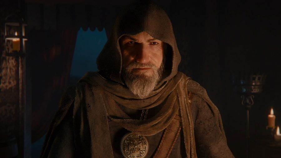 The adviser from Total War: Warhammer, an old man in a brown hooded cloak, wearing several leather wraps and a golden medallion