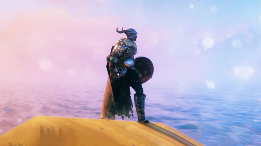 A Viking in Valheim standing in front of a sunrise