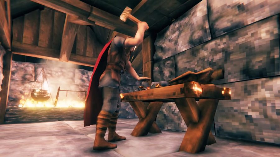 A man crafting items at a workbench in Valheim
