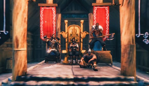 Four Viking warriors sitting in a hall in Valheim