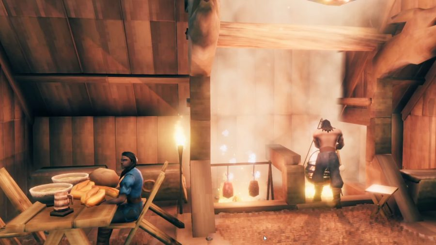 A man stands over a cauldron, cooking, while a woman sits at a table in Valheim