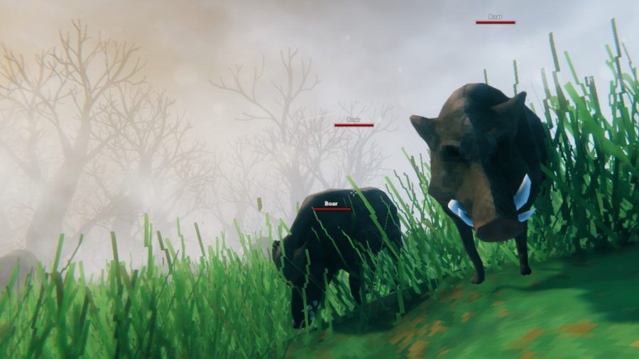A pair of Valheim boars, standing on a grassy hill