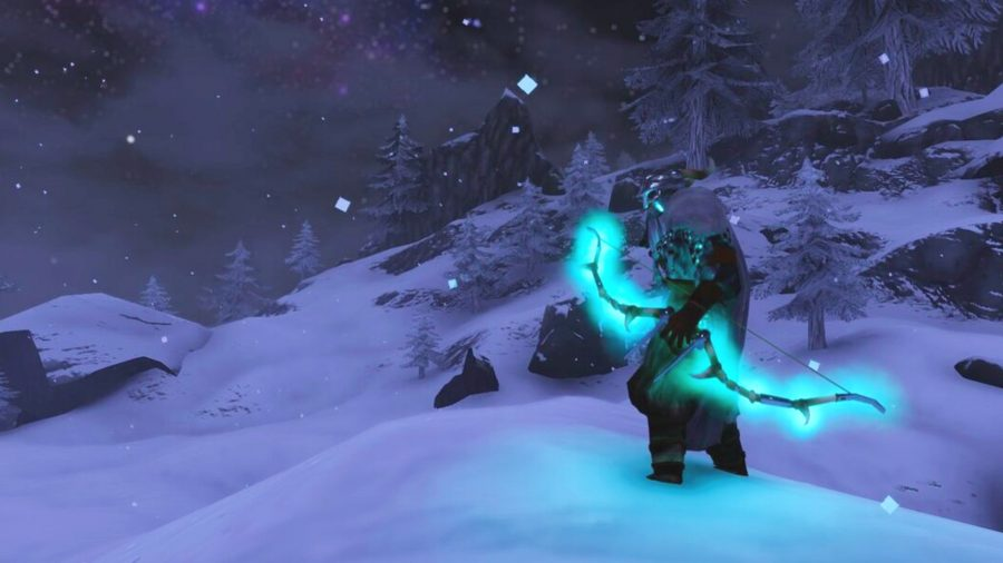 A Walheim figure with a glowing blue arc, standing on top of a snowy mountain