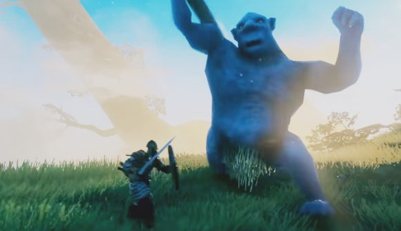 A warrior in Valhelm fighting a huge blue troll, using a sword and shield
