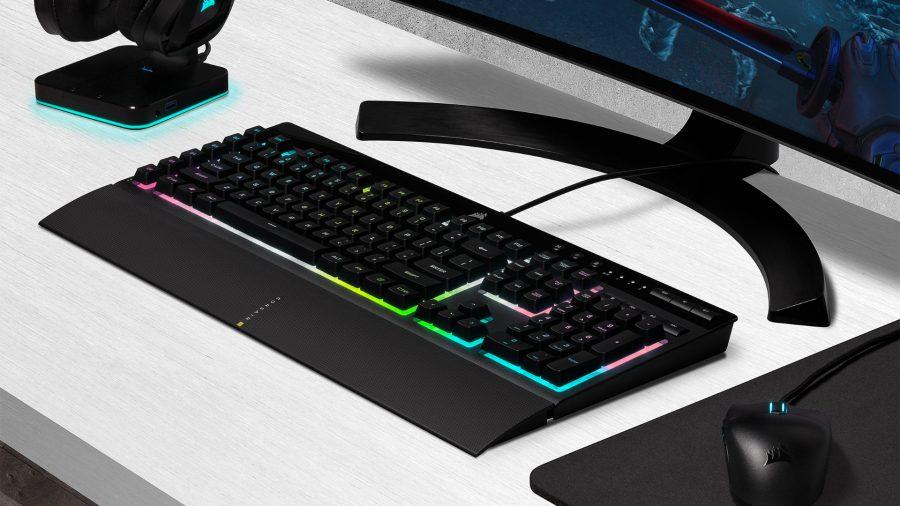 Corsair's K55 RGB Pro XT gaming keyboard sits next to a mouse and monitor