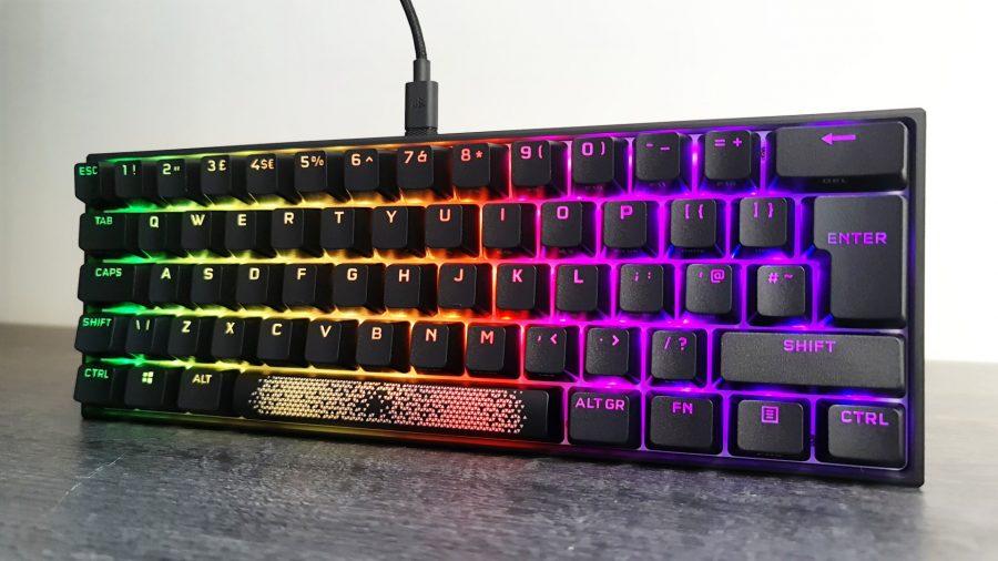 Corsair's K65 RGB Mini stands upright with RGB shining through the keys