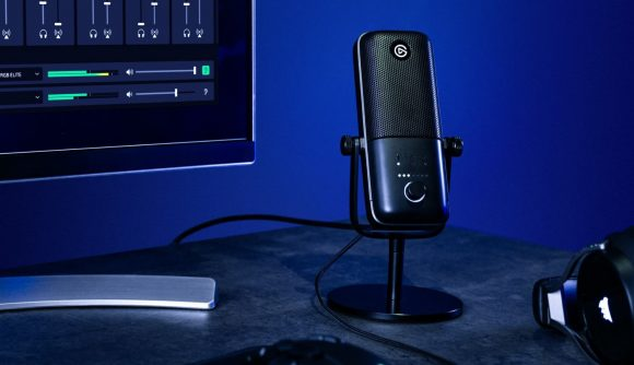Elgato's Wave 3 gaming microphone sits on a gaming desk next to Corsair headphones, pointed at the user
